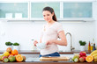 Young woman preparing cereals for breakfast 4