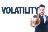 Business man pointing the text: Volatility poster