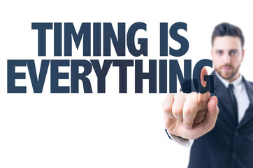 Business man pointing the text: Timing is Everything