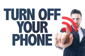 Business man pointing the text: Turn Off Your Phone