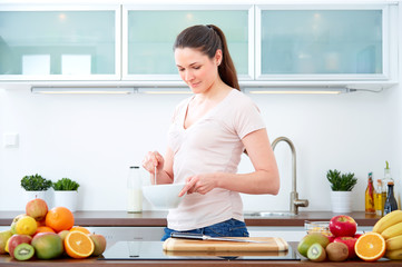 Young woman preparing cereals for breakfast 3
