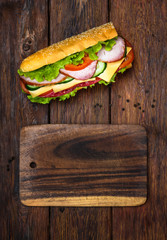 Sandwich with salami, cheese and vegetables