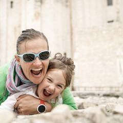 Caucasian mother and daughter hugging, smiling