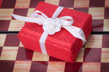 red gift box on a chessboard
