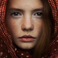 portrait of a beautiful girl with freckles. closeup photo