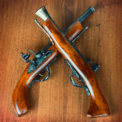 retro pistols on a wooden background