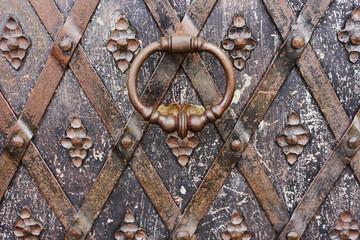 fragment of an ancient metal door with handle