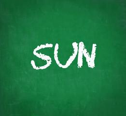 SUN written on chalkboard