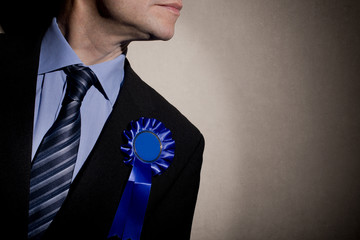 Election Candidate With Blue Rosette
