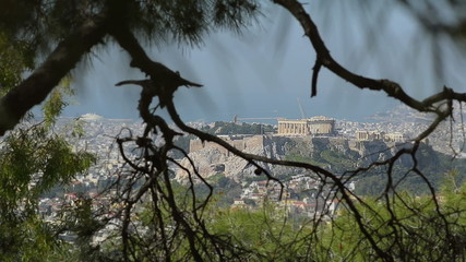 View of the Acropolis through branches of trees