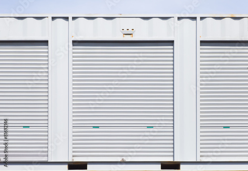 Exterior of white storage unit or small warehouse for rental - 81692146