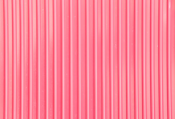 Pink corrugated metal background and texture surface.