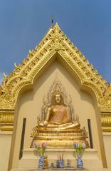 the gold sitting buddha statue under sunlight