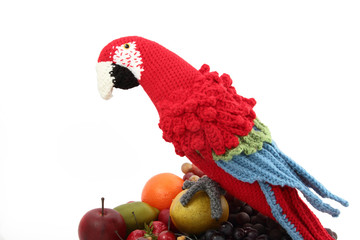 Crocheted Red And Blue Macaw On Faux Fruits