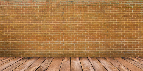 Wood floor and brown brick wall background
