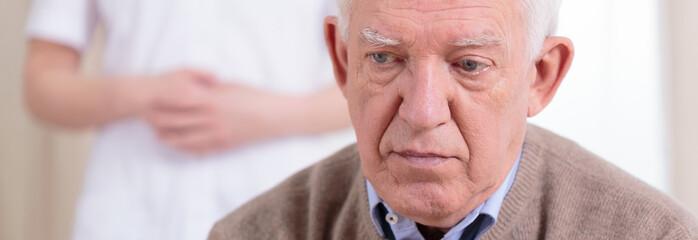 Portrait of sad retiree