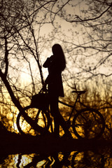 woman with bike silhouette