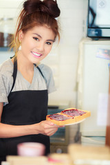 Asian women  smile  bright teeth  cook Bread Chocolate