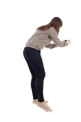 back view of standing young beautiful  woman and using a mobile