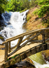 Wooden bridge over the gorge and the Datanla waterfall in Da Lat
