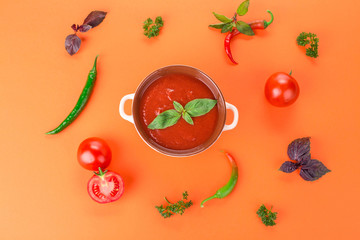 Bowl of tomato soup with basil.