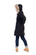 Back view woman in winter jacket  looking up