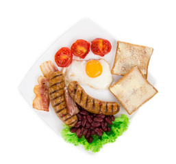Fried egg with sausage on plate.
