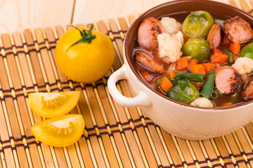 Fresh vegetable soup with sausage.