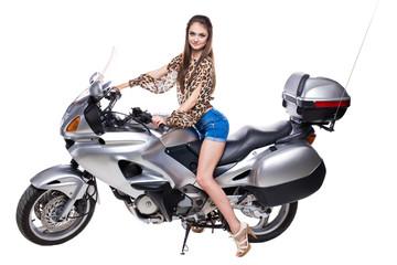 Fashion model sitting on bike.
