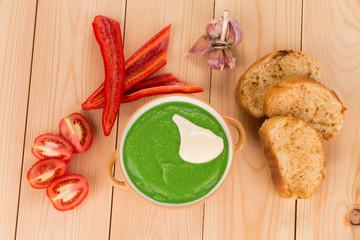 Broccoli cream soup on table.