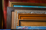 Picture frames are decorated in an art workshop in