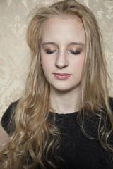 Young beautiful girl shows off  makeup