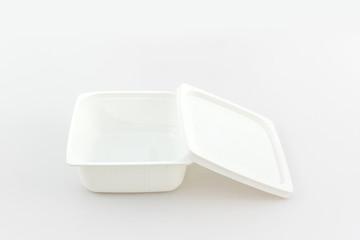 White plastic food box on white background.