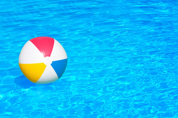 Inflatable ball in swimming pool