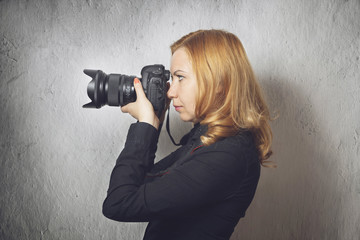 Woman photographing with professional camera