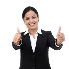Cheerful woman with thumbs up against white background