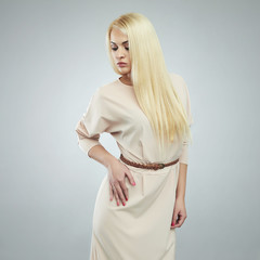 beautiful young woman in dress.Fashionable blond girl