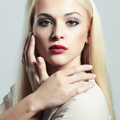 Young Blond woman with manicureBeautiful girl make-up