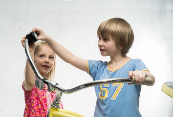 Children with bicycle