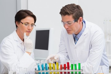 Scientists working attentively with test tube
