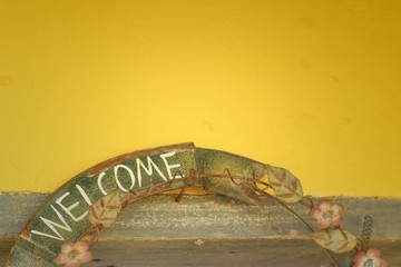 welcome vintage sign on a yellow background