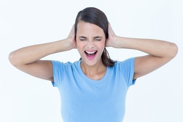 Screaming woman covering her ears