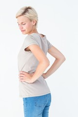 Blonde woman suffering from back pain