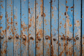 Rusted blue painted metal wall