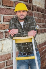Composite image of manual worker