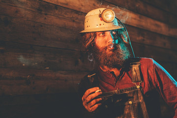 Miner Wearing Helmet Lamp and Smoking Cigarette