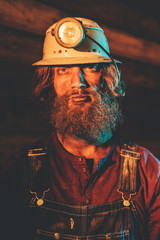 Bearded Miner Wearing Helmet Lamp and Overalls