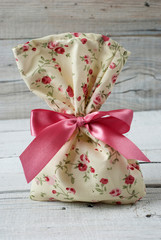 Fabric pouch on old wooden table