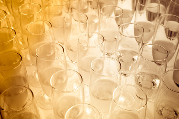 Sepia tone of party glasses filled with champagne