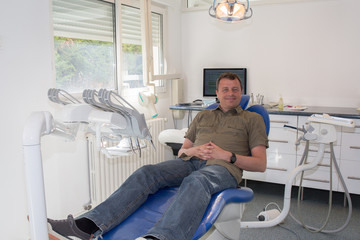 Man patient is waiting for his dentist to cure caries
